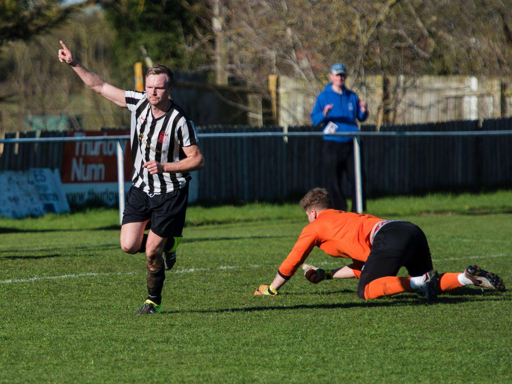 BACK OF THE NET: David Lorimer celebrates bringing Long Melford level against Walsham-le-Willows at Stoneylands Picture: Mark Westley
