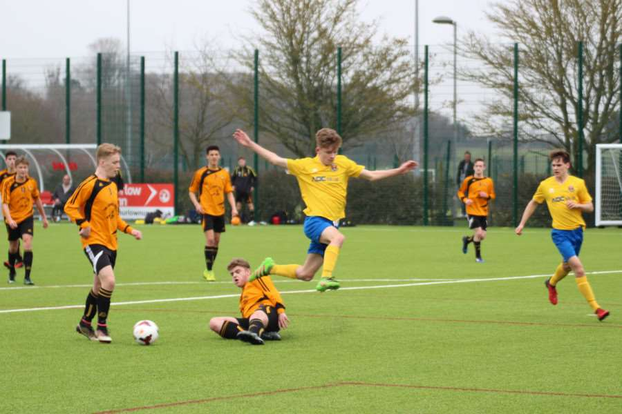 SLIDING CHALLENGE: Action from AFC Sudbury Under-16s' 4-1 win over Mildenhall