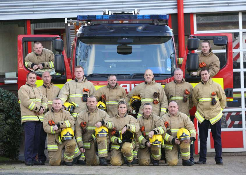 Firefighters from Bury St Edmunds pictured with the appliance that may be lost due to cut backs. ANL-151125-174457009