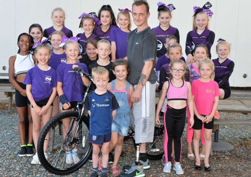 Amputee Paul Clark with members of the Suffolk Stars for whom he plans a 66 mile fund raising cycle ride ANL-160824-104115001