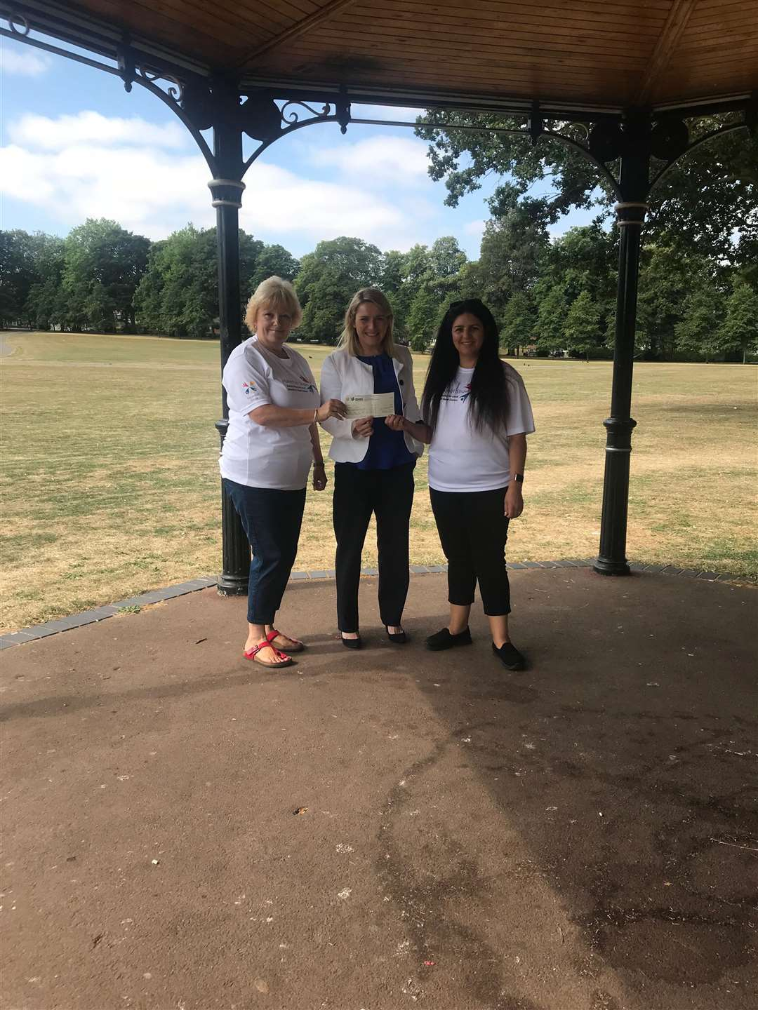 Verity McMahon, head of land at Persimmon Homes Suffolk (centre), presents Community Champions funding to Haverhill Show committee members Kelly Bennett and Lisa Mason (right). (3180036)
