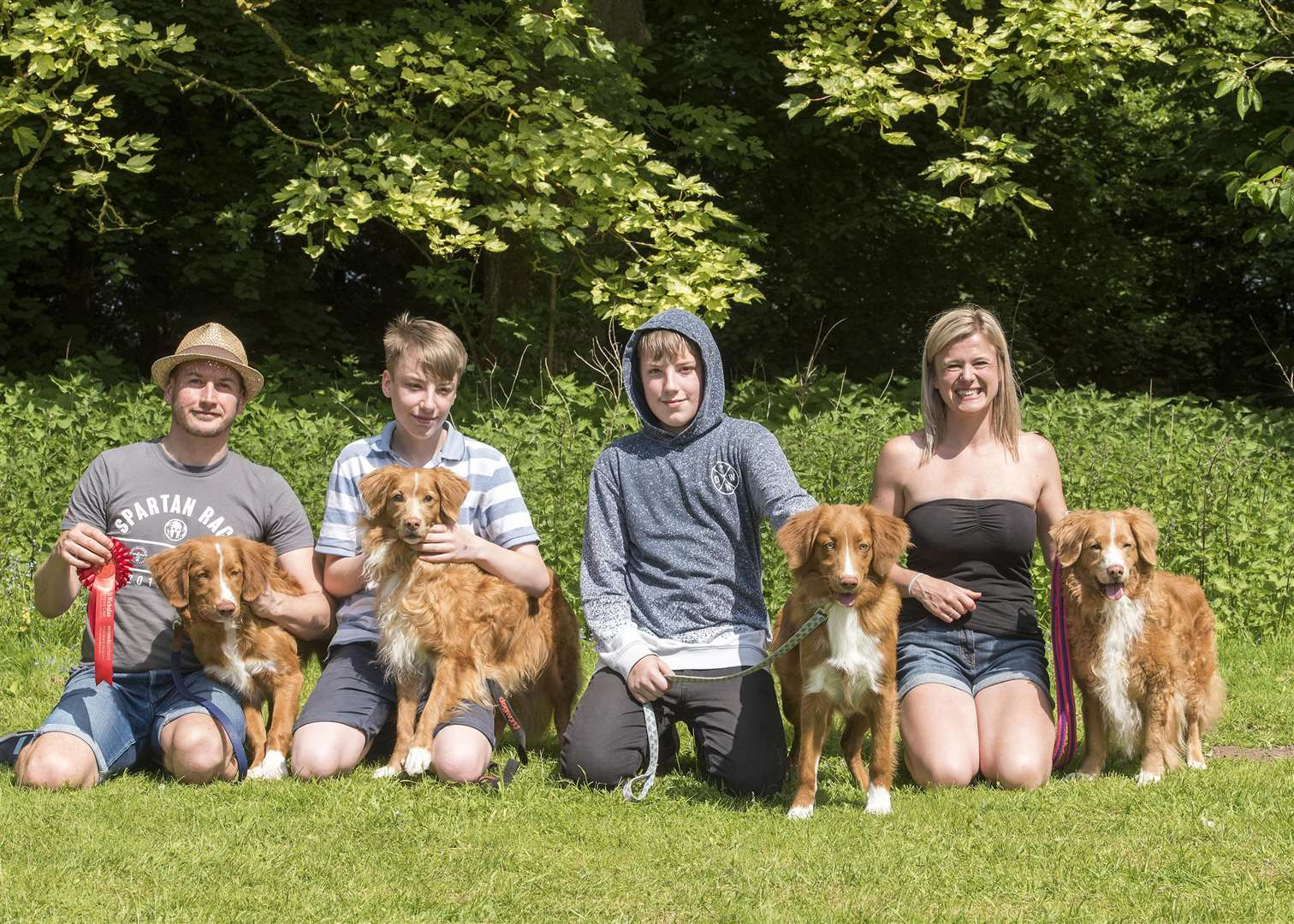 Best dog family Matthew Goulding and Sam Savory with Joshua and Ethan Goulding and their family of nova scotia duck tolling retrievers Picture by Mark Westley (2091499)