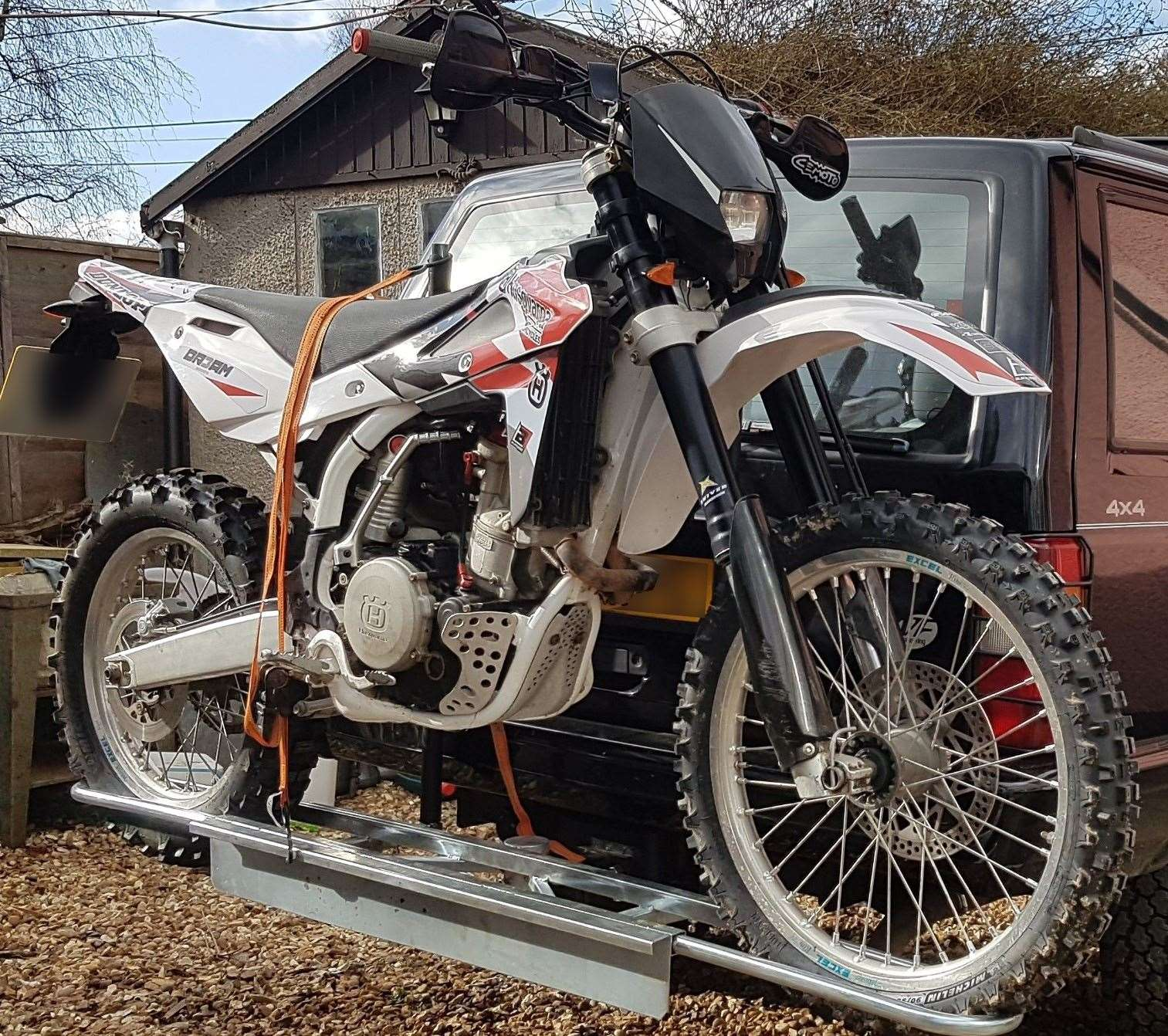 Offenders forced entry to an outbuilding in The Street, Elmsett and stole a white and red Husqvarna motorcycle, registration EU57 SYJ. Photo supplied by Suffolk Police. (22122590)