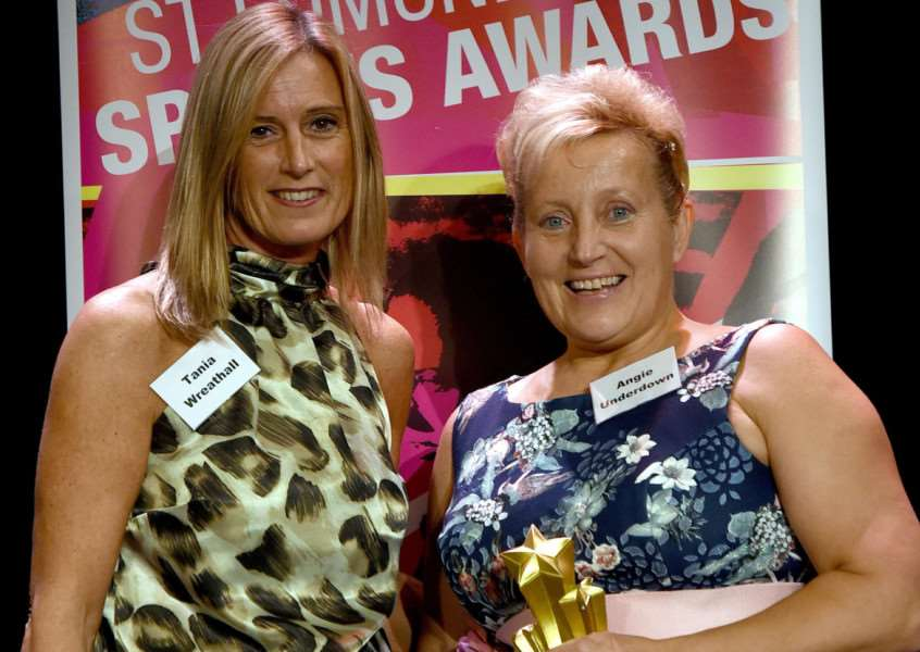 TRIUMPH OVER ADVERSITY: Angie Underdown (right) picks up her award from Greene King's Tania Wreathall
