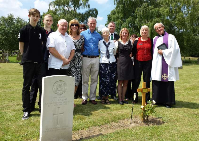 The family of Annie Dureall, who died in a zeppelin raid with her two children in 1916, placing a marker on her grave in 2014 ANL-140617-143148001