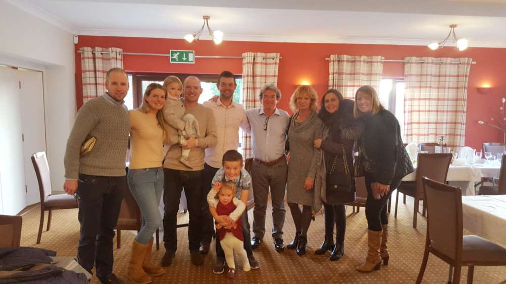 Garry Kerr and Mick Carter (centre) with their families at Haverhill Golf Club