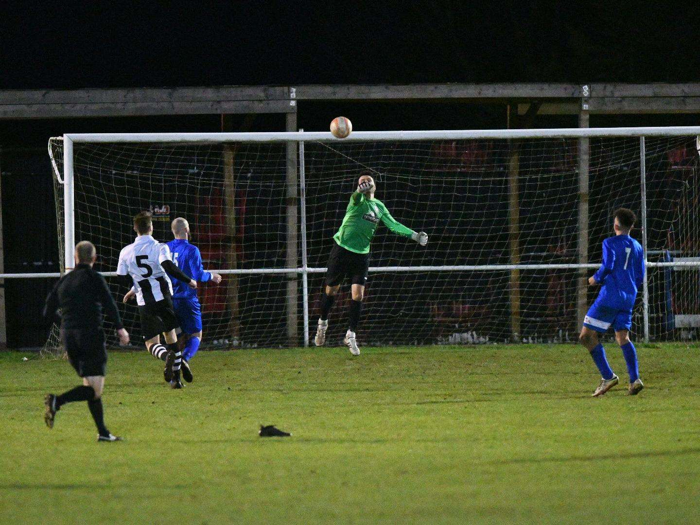 UNDER PRESSURE: Long Melford's Darren Moyes punches clear during his side's 2-2 home draw with Kirkley & Pakefiled at Stoneylands Picture: Mark Bullimore