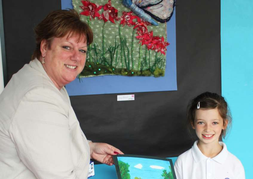 Honey Mangion, the winner of the Ormiston Sudbury Academy art competition for primary school children in the area, with academy principal Caroline Wilson. ANL-150723-101942001