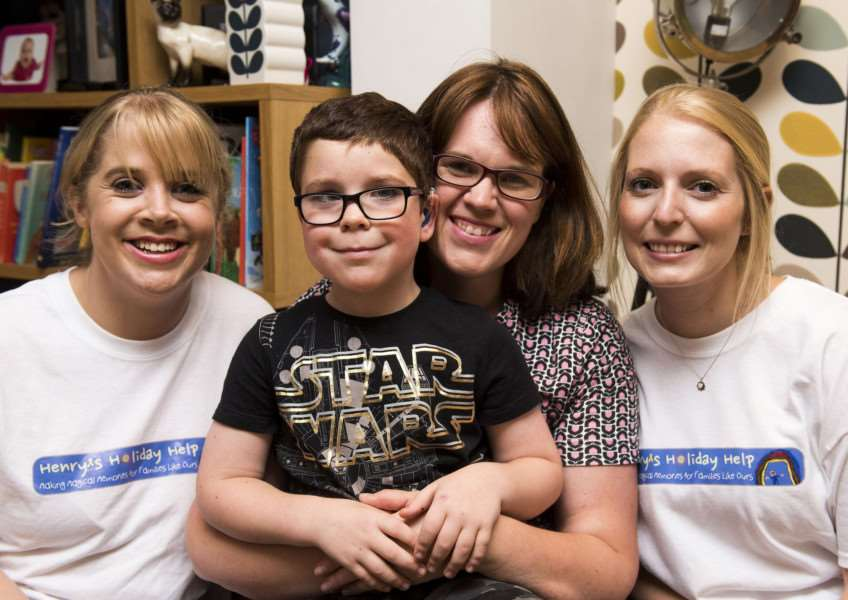 Team doing a 26-mile walk in aid of Henry's Holiday Help, a local charity.'Lizzy Whitmore right and Kierene Studd Reception Class teachers doing the walk with Katie Dalgoutte and her son Henry'Picture Mark Westley