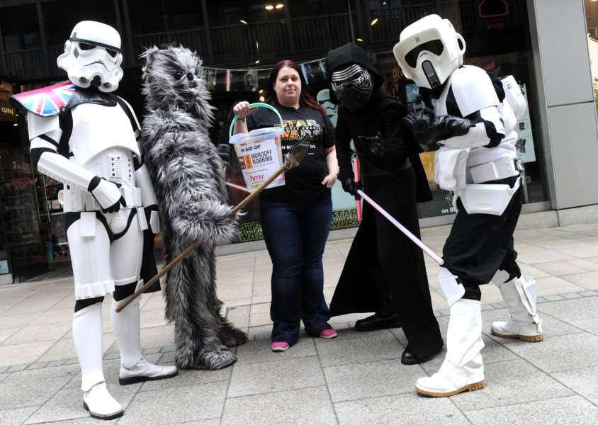Norwich Star Wars club Suffolk Division were at HMV''Pictured: Star Wars characters with Camilla Bone (HMV stock room assistant) ANL-160425-005000009