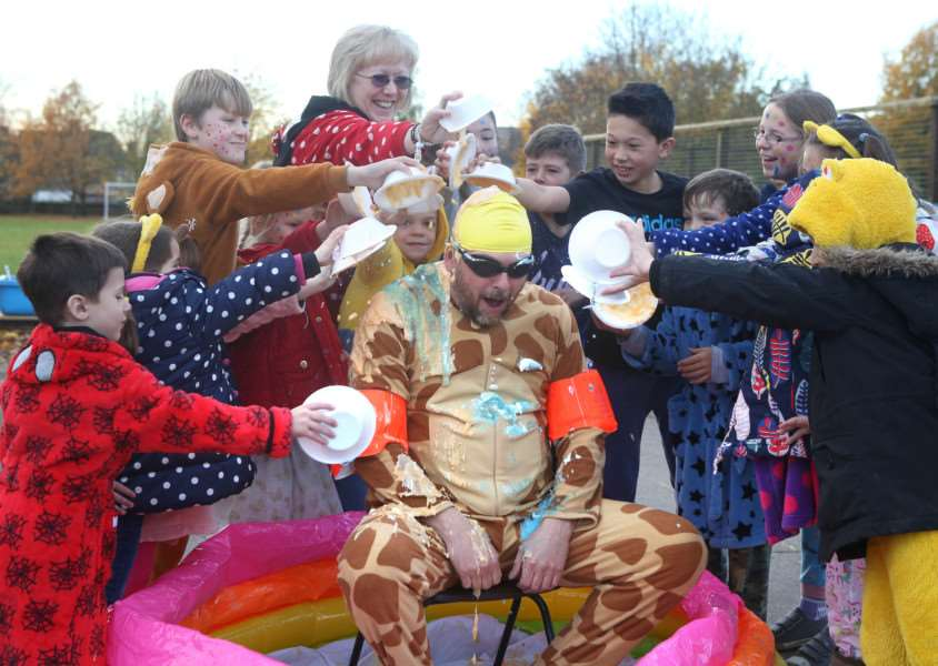 School caretaker, Gary Aitken gets gunked by staff and pupils at Long Melford Primary school to raise money for Children in Need ANL-161118-170042009