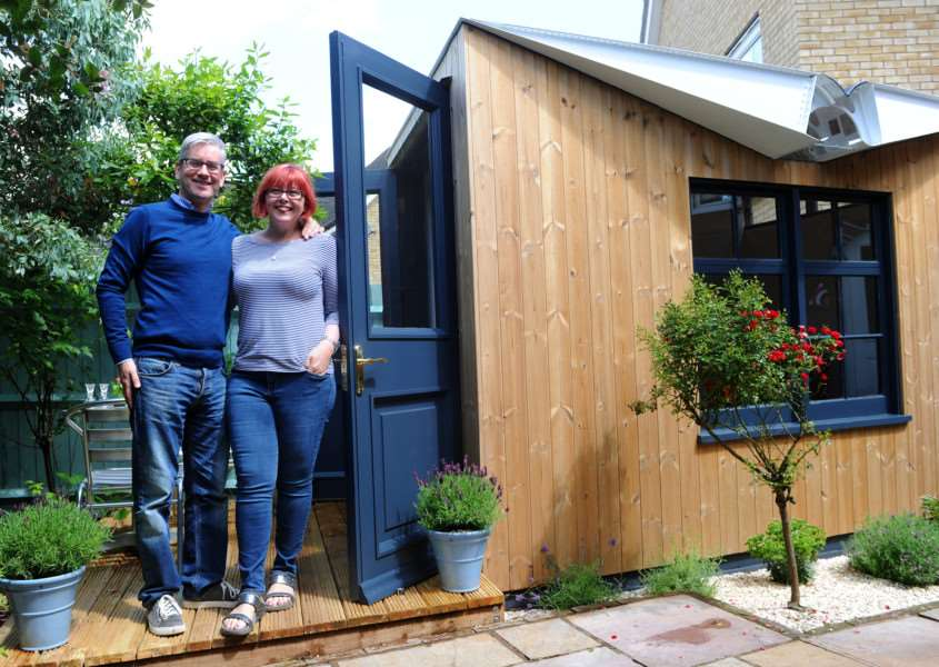 Adrian and Karen Cannard with their up cycled garden room