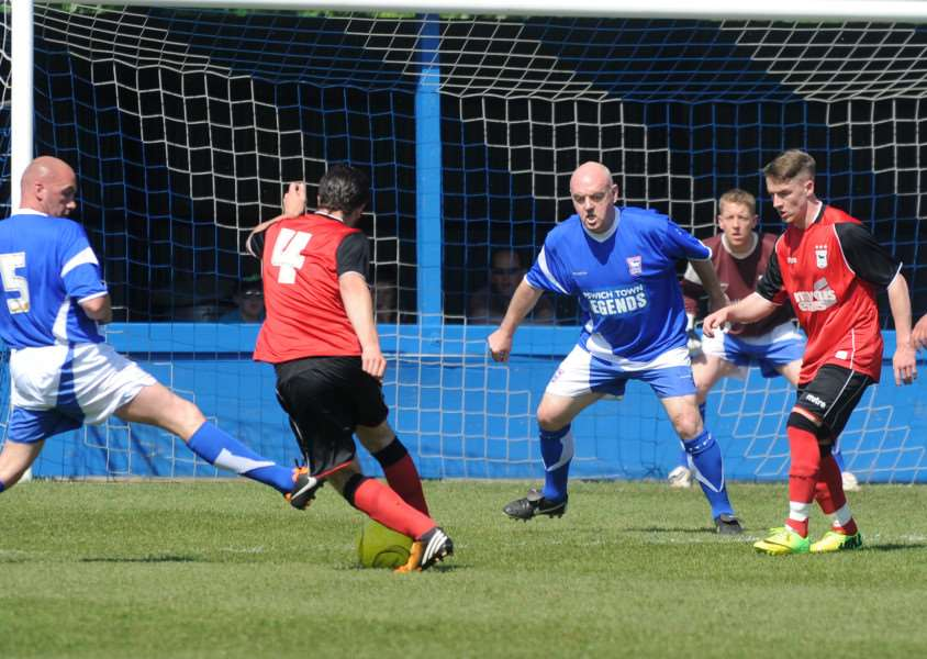 FOOTBALL - Ipswich Town Legends dementia/academy charity match at Bury Town Bury Town FC - Shane Supple in goal and John McGreal and John Wark in defence Pictures: Mecha Morton