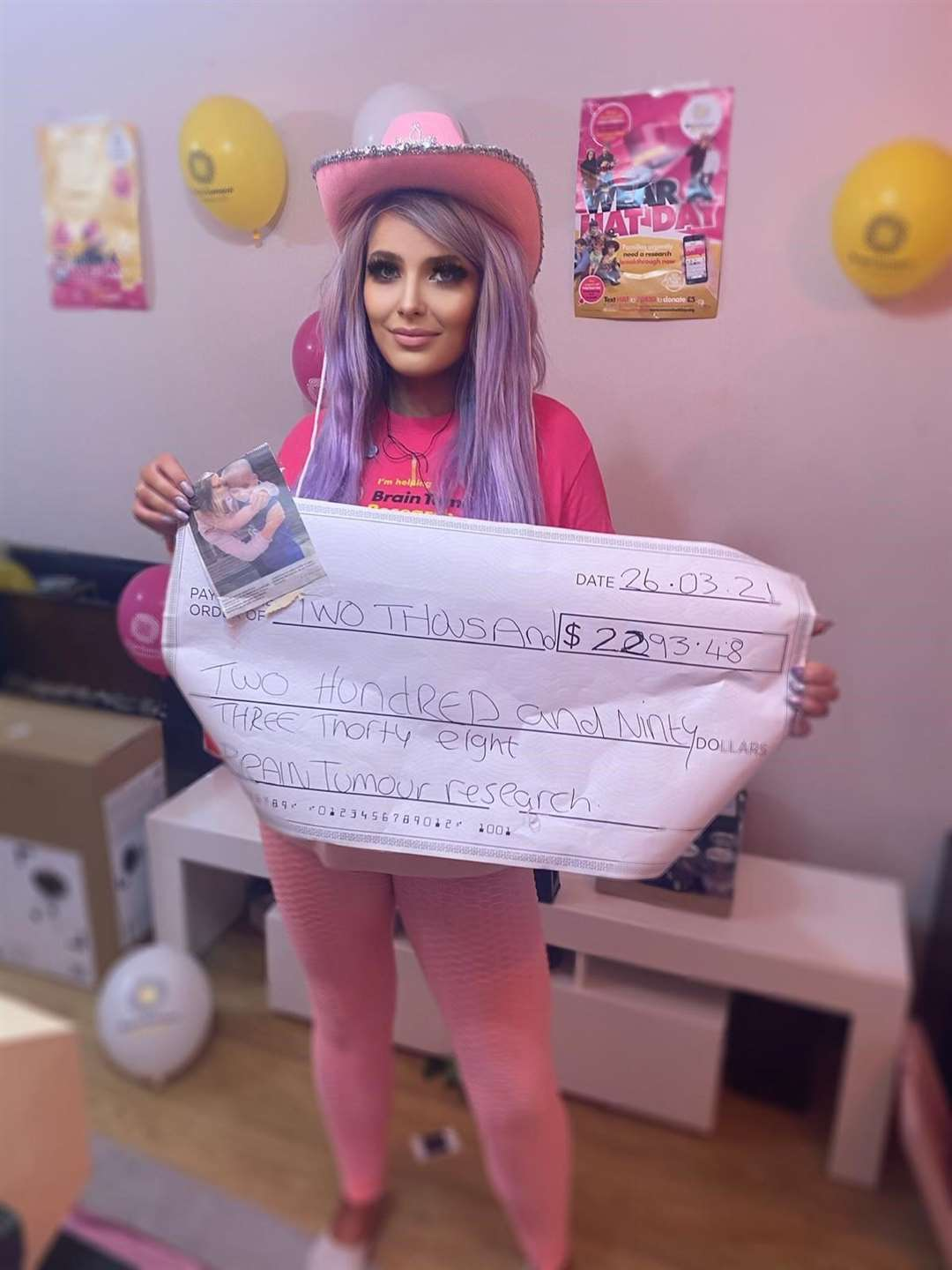 Mel Morris with the cheque for £2,293 made out to Brain Tumour Research. Submitted picture