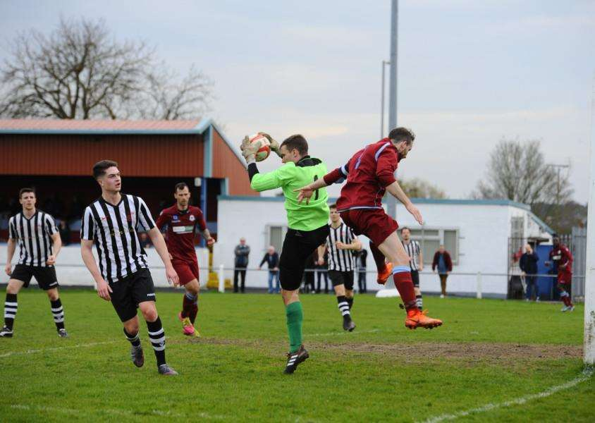 'KEEPER'S BALL: James Scammell claims a ball into the box ahead of Thetford's Sam Bond in Saturday's 1-1 draw. Picture: Mark Bullimore