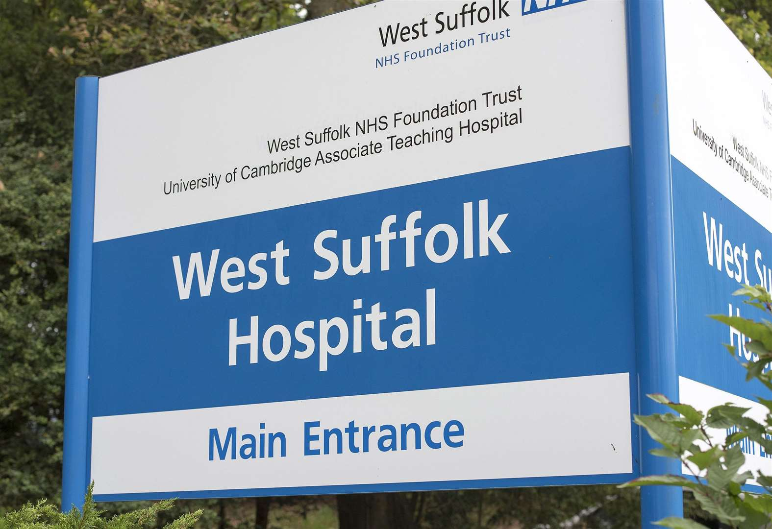Why have West Suffolk Hospital patients been left isolated from the outside world?