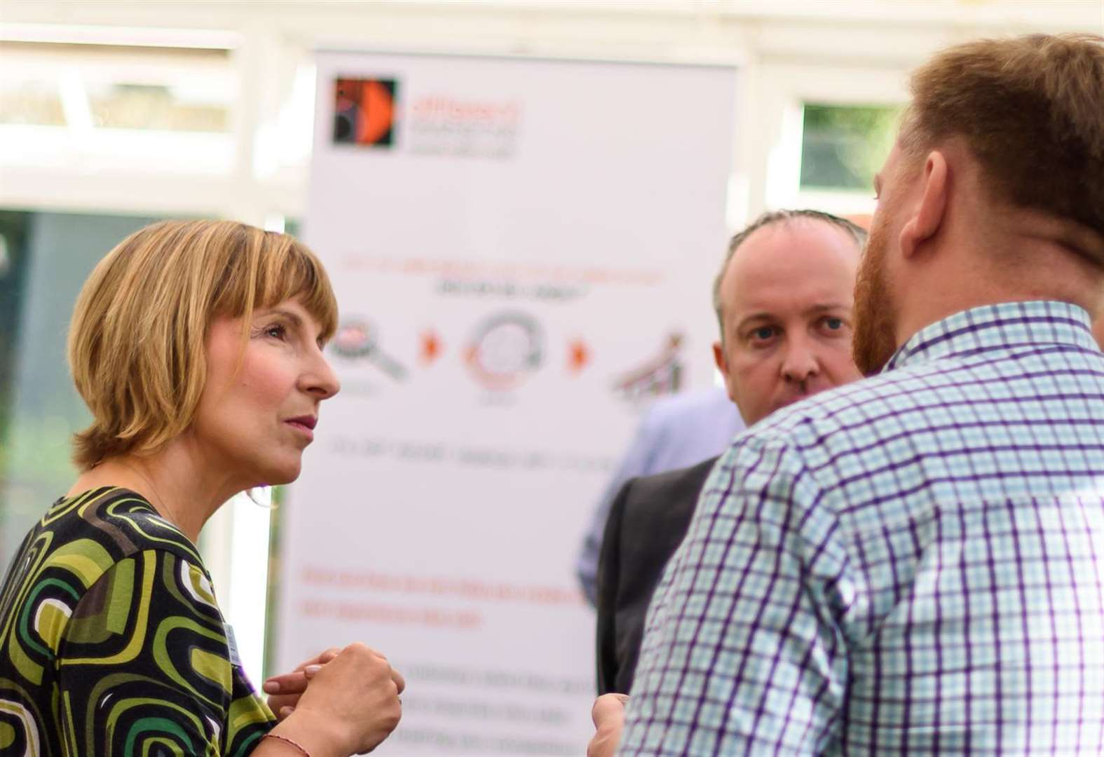 Networking over coffee at business event near Haverhill