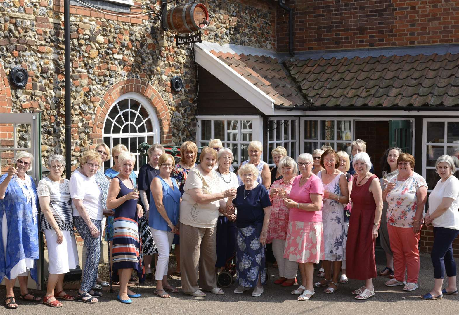 Greene King Mothers' Group members raise a glass to 130 years