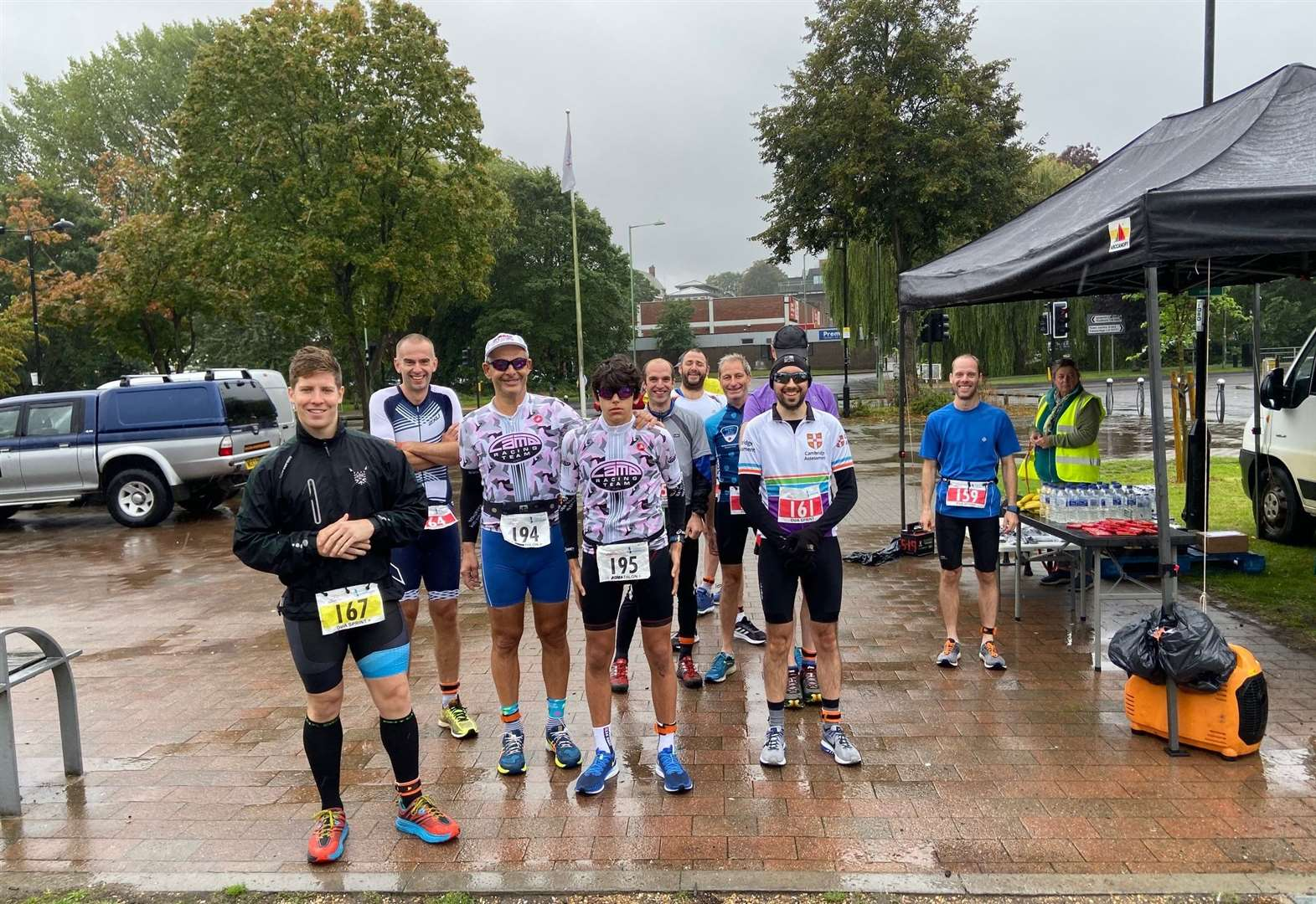 Triathletes keep on smiling despite deluge and floods