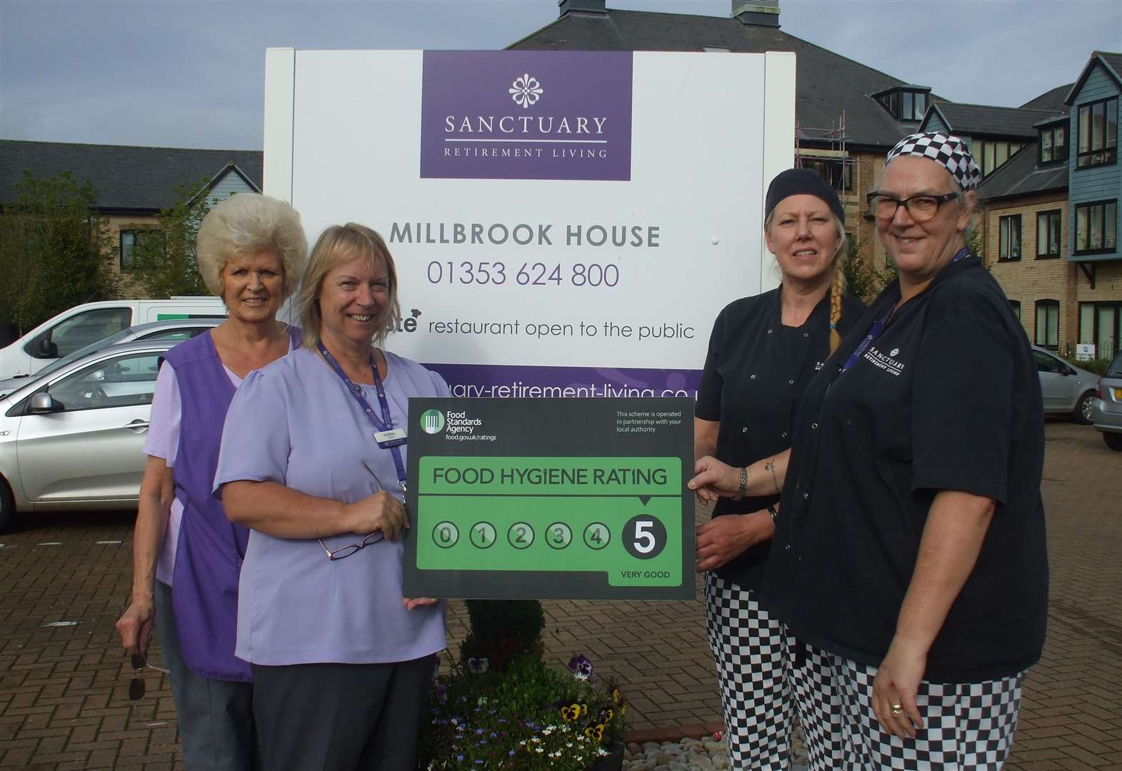 Staff celebrate at Soham retirement flats after restaurant given five-star rating