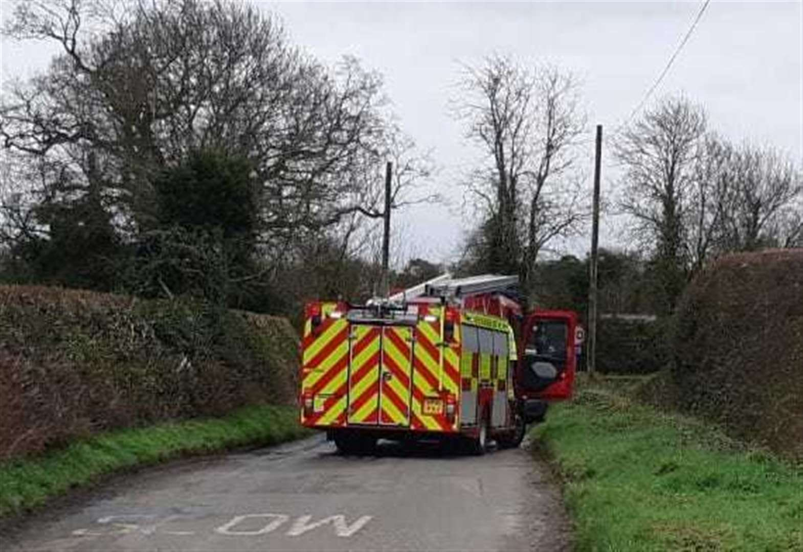 Man rescued by passer-by after crashing into a pond just outside Newmarket