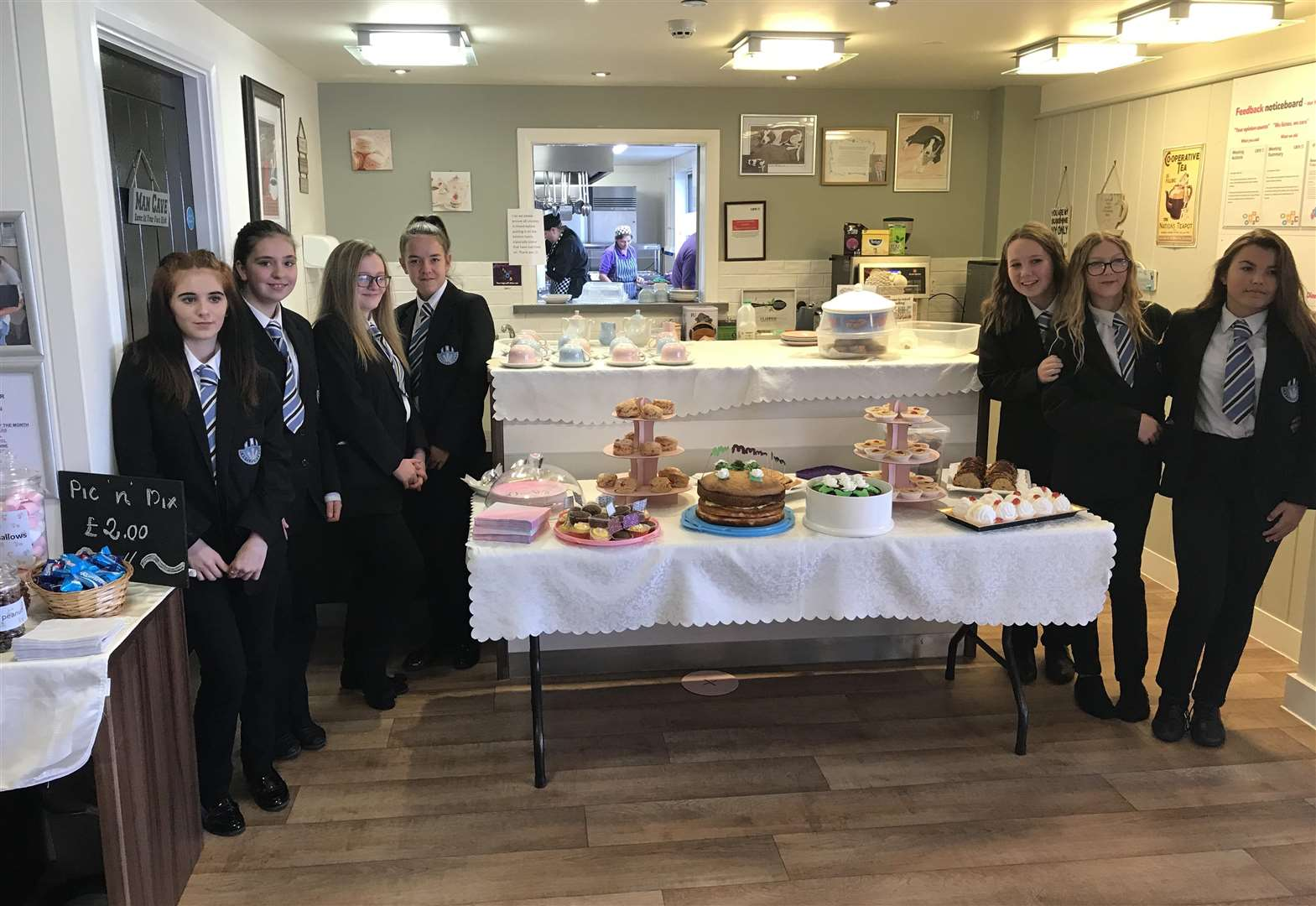 Kind-hearted students give something extra at care home coffee morning