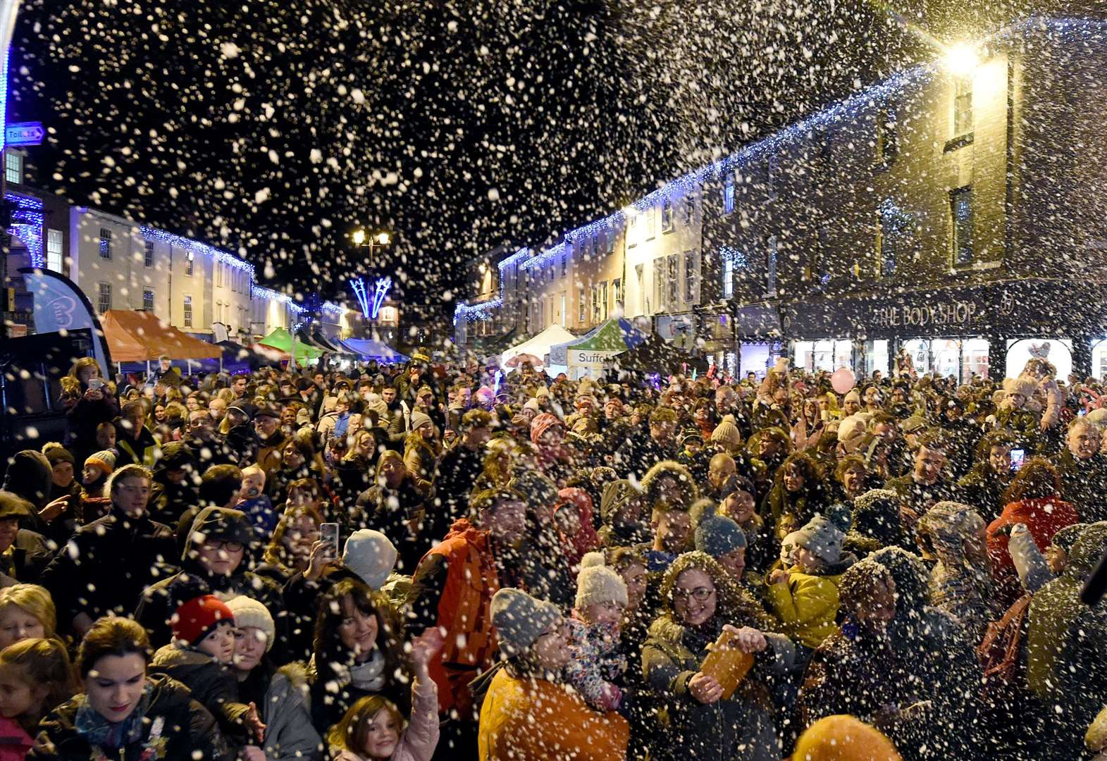 Christmas arrives in town as hero switches on the lights