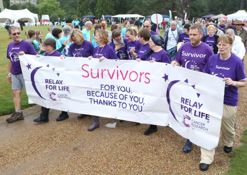 Survivors and team members take part in last year's 24hr Relay for Life in aid of Cancer Research UK.'Pic - Richard Marsham