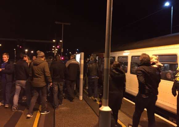 Passengers try to board the already crowded 10.19pm train at Ipswich Station after the match ANL-150701-125718001