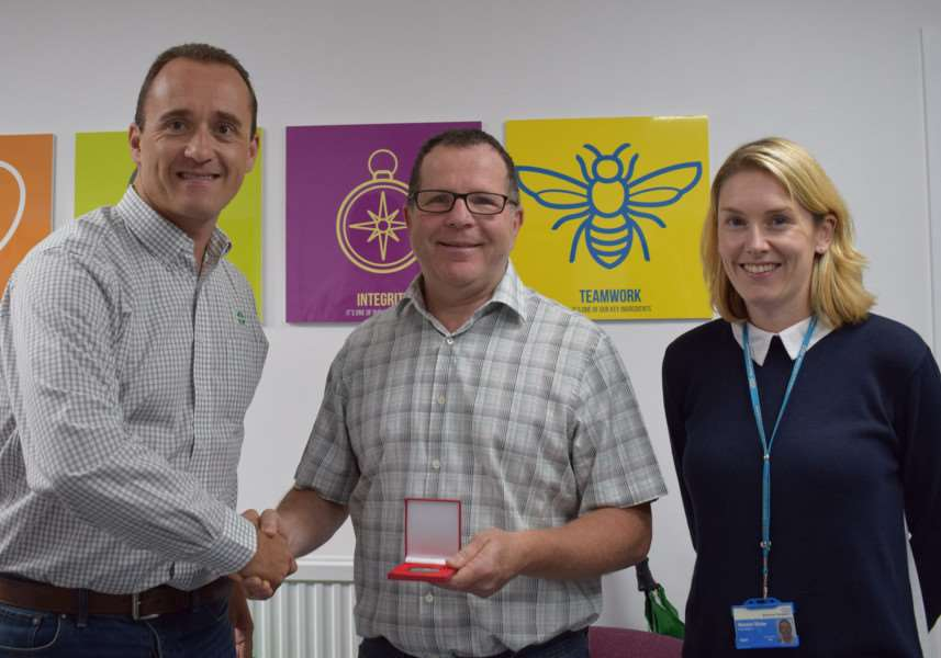 Tony Allen is awarded a medal by Daemmon Reeves, Treatt Group CEO, and Natalie Shaw from NHS Blood and Transplants.