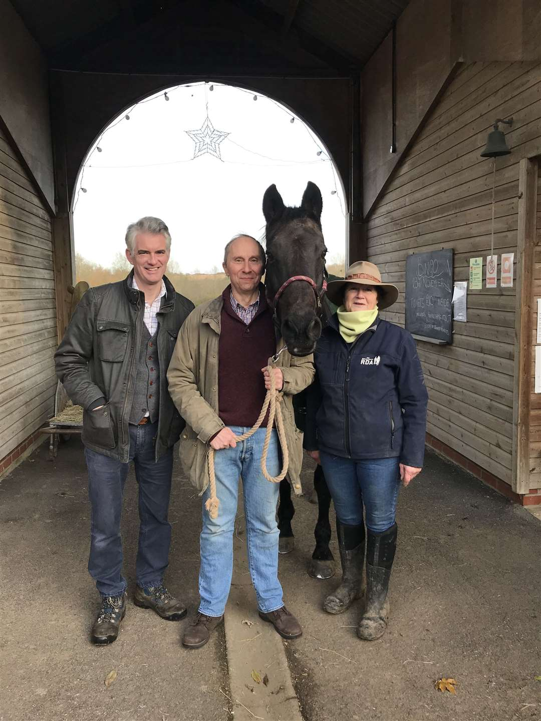 The Shelley Centre for Therapeutic Riding. Pictured: South Suffolk MP James Cartlidge, Babergh District Council leader John Ward and stable manager Lyn Bensusan, with Parys, one of the centre's horses. Contributed picture. (26171791)