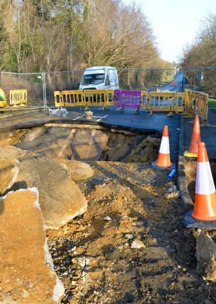 A large sink hole has appeared in Newton Road, Sudbury, Engineers from Anglian Water are repairing the site.