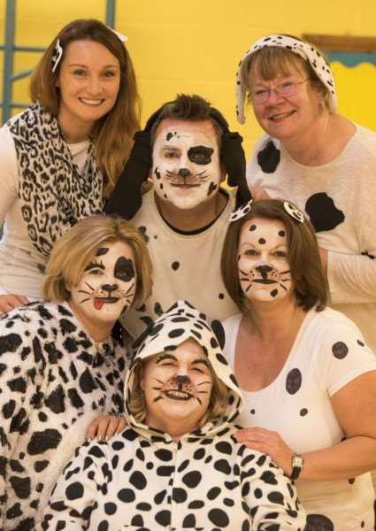 Ickworth Park Primary School staff and teachers dressed as dalmatians:, Head teacher Denise Burrell with Sarah Thomas, Nicki Asker, Sue Woodley, Alistair Phillips and leigh Isaac' ANL-161118-165305009