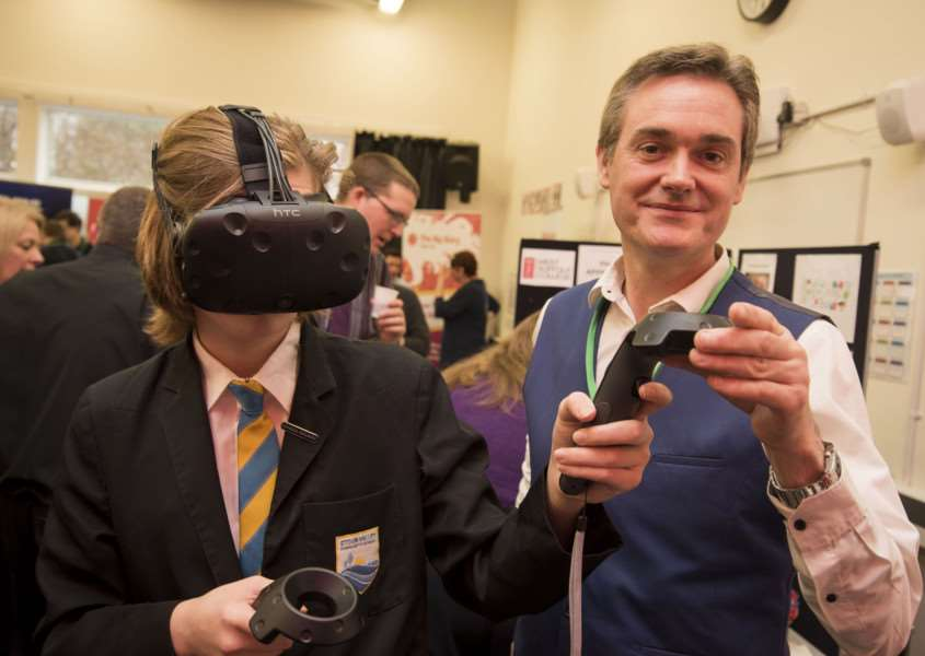 Stour Valley Community School, Cavendish Rd, Clare, Sudbury'School STEM fair (science fair)'Peter Harbron Head of School Computing at West Suffolk College with Merlin Wittam testing out the lastest VR headset'Picture Mark Westley