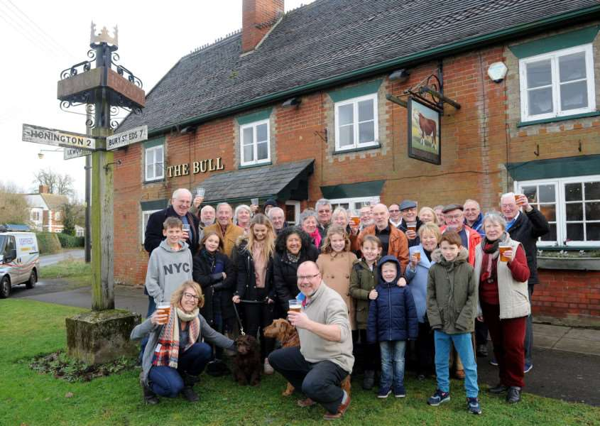 Villagers celebrate the reopening of The Bull in Troston ANL-170301-155023009