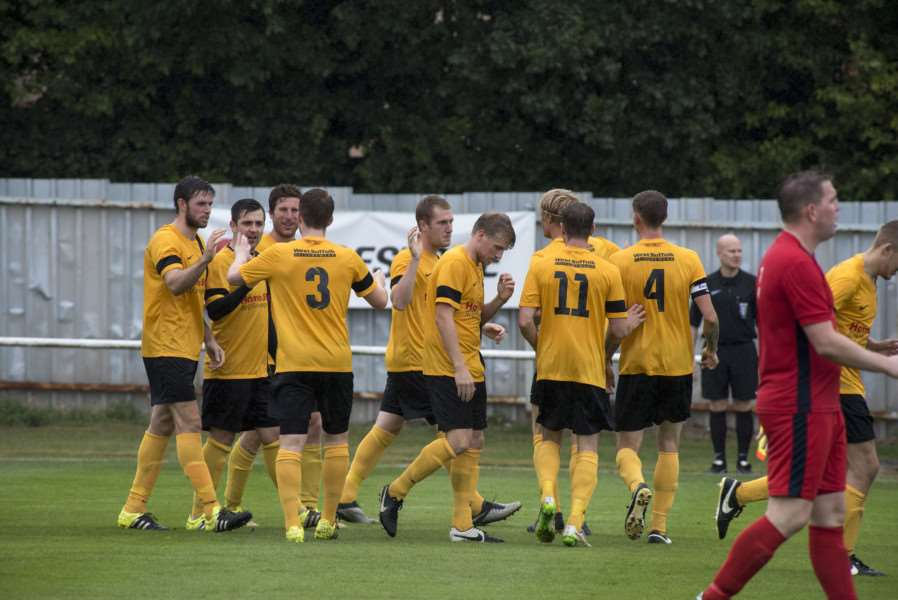 TOUGH DRAWS: Mildenhall players celebrate Ross Munro's goal against Hadleigh ahead of the FA Vase outing away at Wisbech Town.