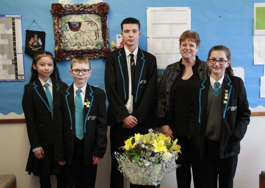 Ormiston Sudbury celebrate after achieving a good rating in their Ofsted report. Students with head teacher Caroline Wilson