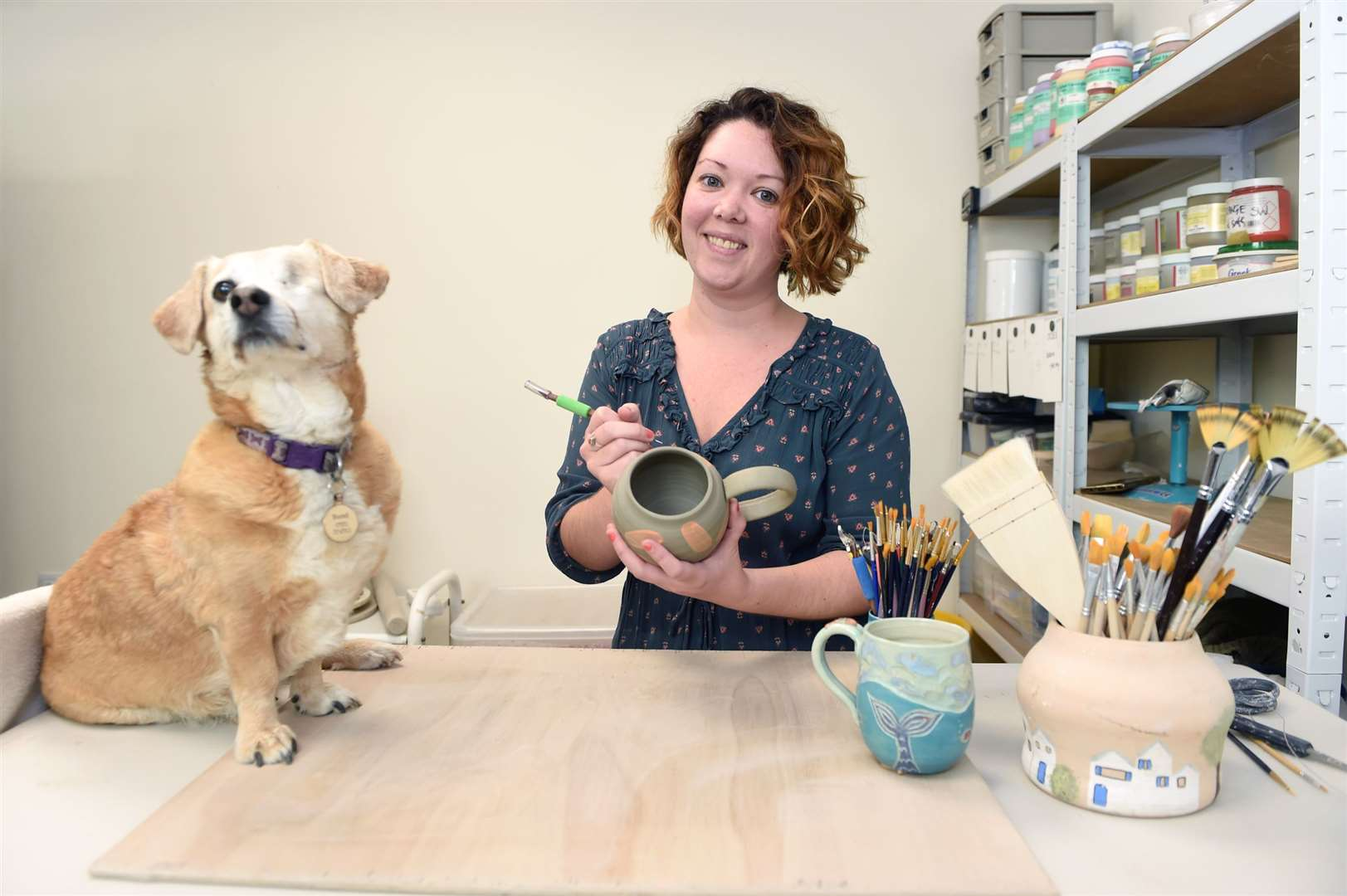 Rachel Pedersen will be showcasing her ocean-themed pottery work during an upcoming open studios event in Sudbury.Pictured: Rachel with her dog BluebellPICTURE: Mecha Morton (42290161)