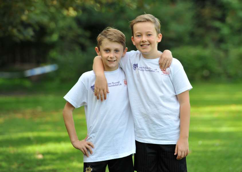Archie Cowe and Theo Boxall, both 9, are doing a 3 mile run to raise money for Team PP,a fundraising group set up in memory of a 21-month-old girl, Phoebe Knibbs, who died of Krabbe Disease.