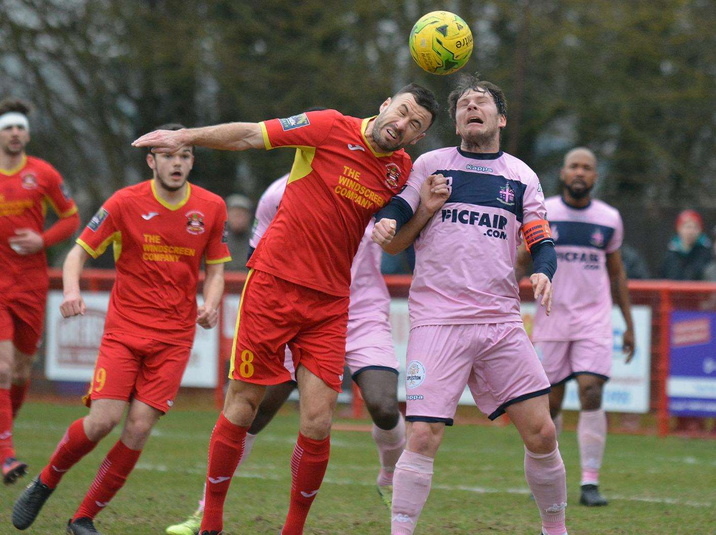 AERIAL BATTLE: Needham Market captain Gareth Heath wins a header against league leaders Dulwich Hamlet Picture: Ben Pooley