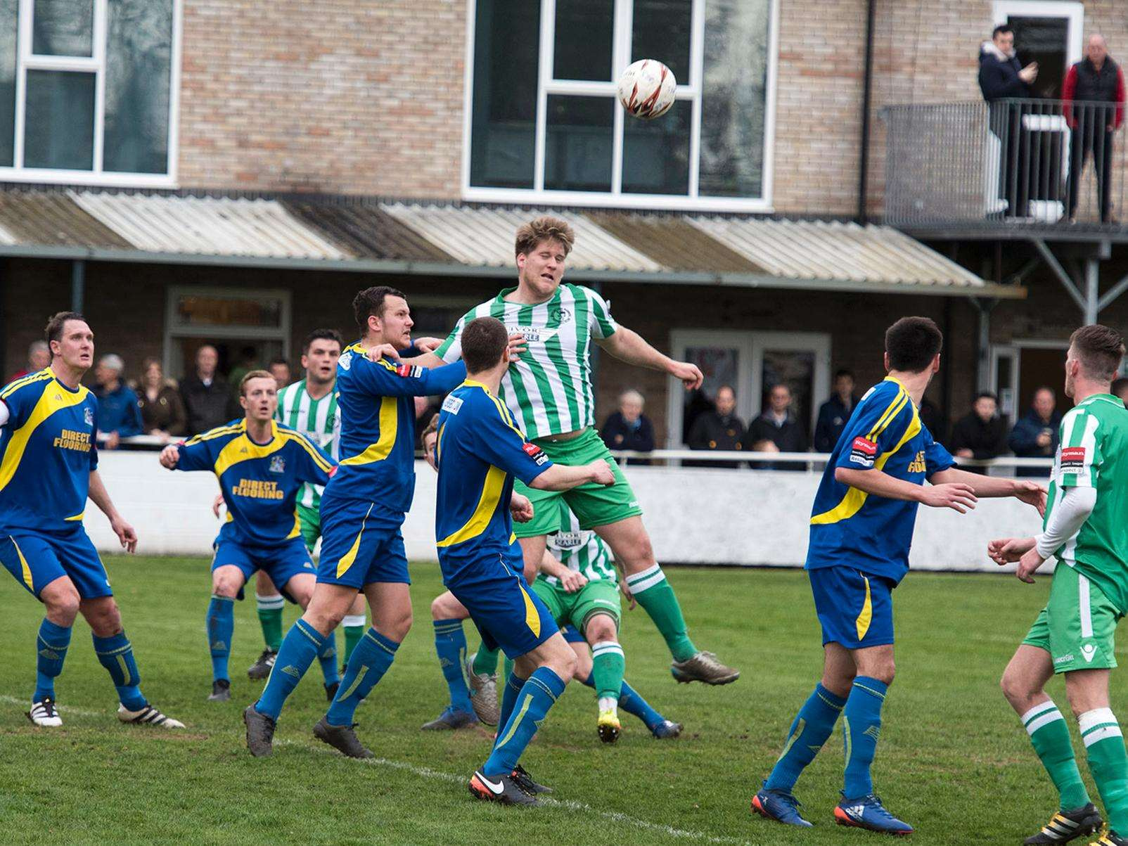 HEADS UP: Soham's Lloyd Groves attempts to force the ball goalwards during the crucial win over Thurrock