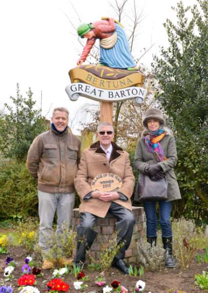 Carver of the sign Robert Lewis , Councillor and organisor Andrew Hill and painter of the sign Diana Burnard