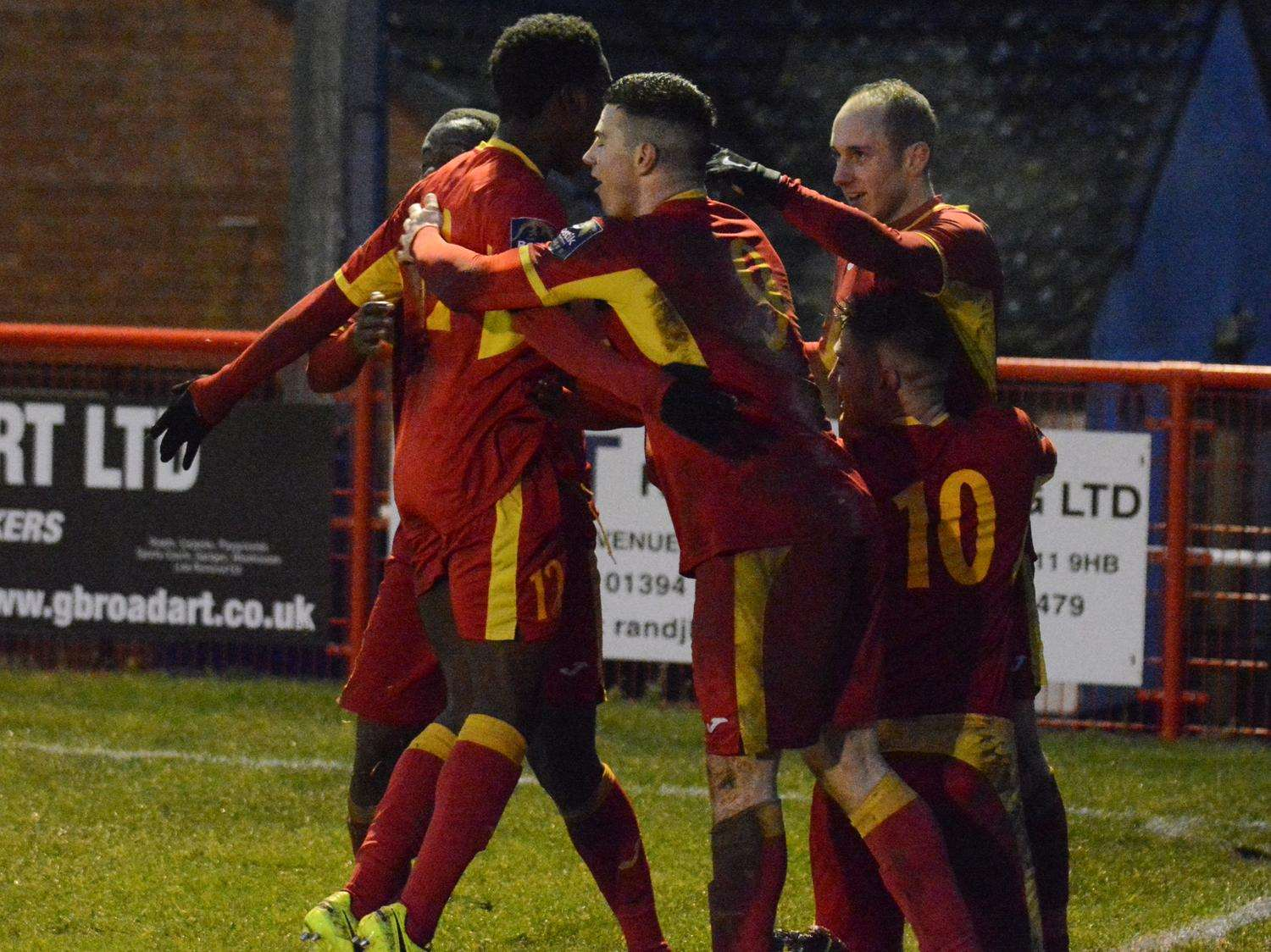LATE JOY: Needham Market players celebrate Adam Mills' late goal at Bloomfields, which earned them an important point against play-off chasing Hendon Picture: Ben Pooley