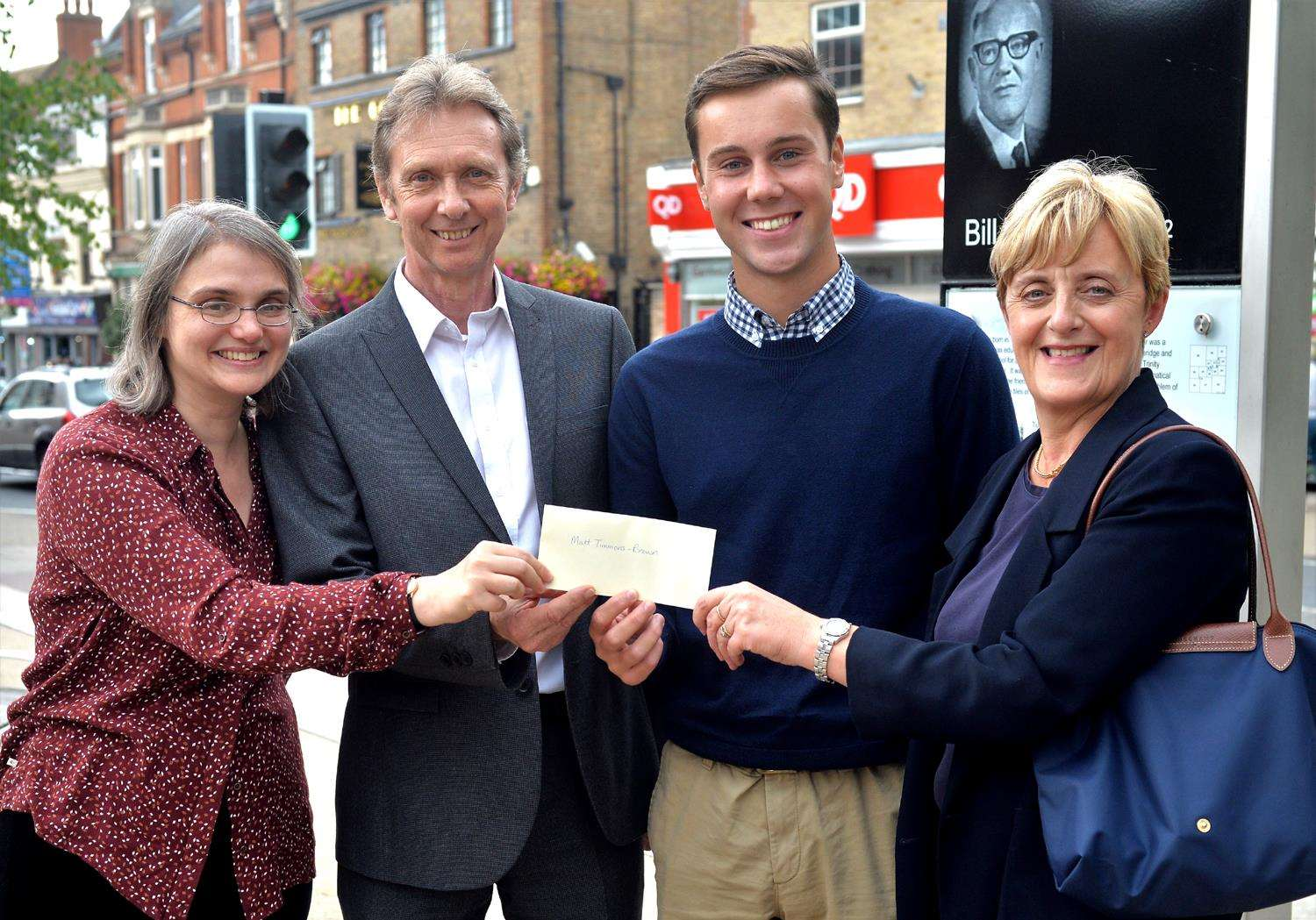 Matt Timmons-Brown receives a cheque for £1,000 from Bill Tutte scholarship committee members Rachel Wood, Michael Jeffreys and Alison Hayes