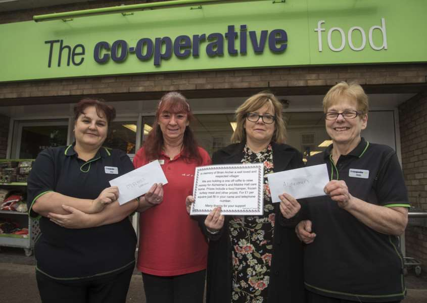 Sheila Chaplin and Cheryl Hayward of Lakenheath Co-op, with Brian's daughter Carol Archer and Patricia Fuller, of Mabbs Hall Care Home