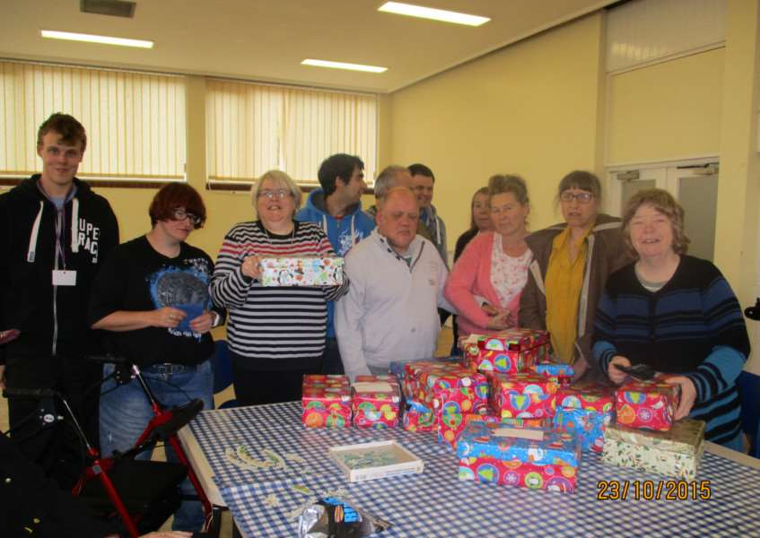 Members of the Befriending Scheme's Haverhill Hub with the shoeboxes. Contributed picture. ANL-150911-124713001