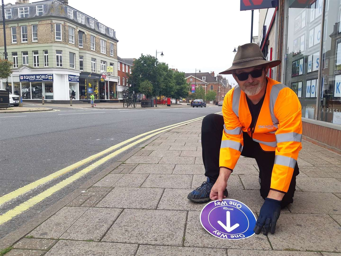 Oran Redmond, programme manager at West Suffolk Council, placing one way signs on Newmarket's High Street on Friday Picture: Dan Barker (36621357)