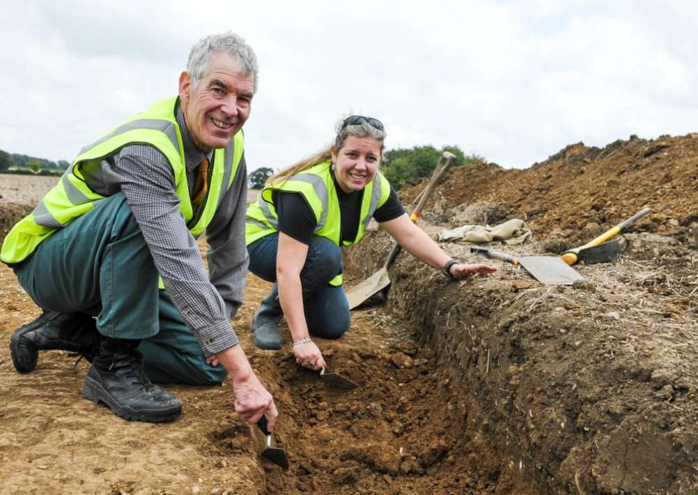 Archaeological dig at 'Goldingham Hall, Bulmer. FL; Historian and land owner Ashley Cooper and Laure Bonner. ANL-140913-191113009