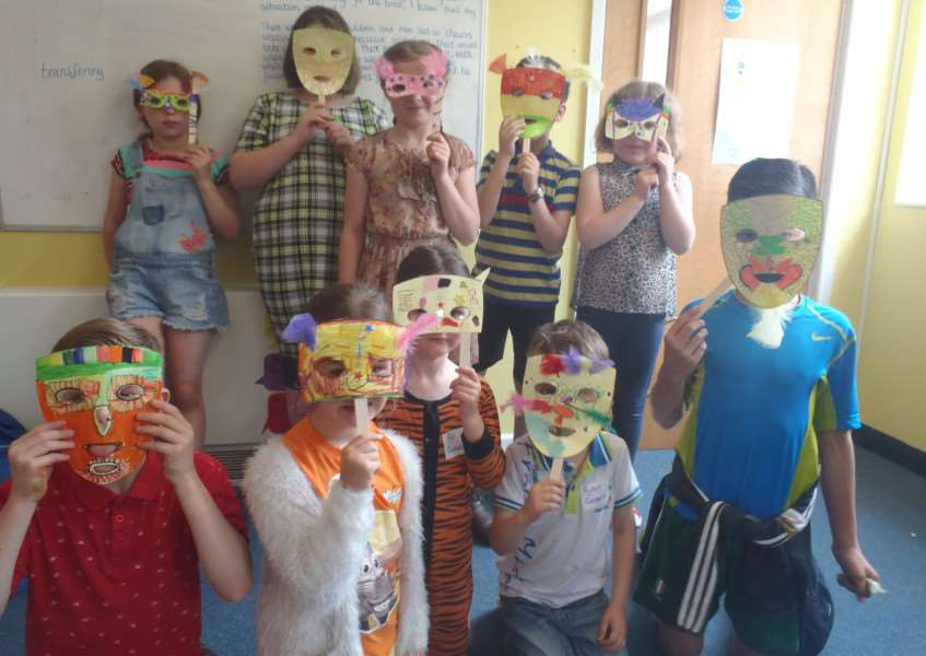 Kedington Primary Academy pupils with some of the African animal masks made during international week ANL-151006-162117001