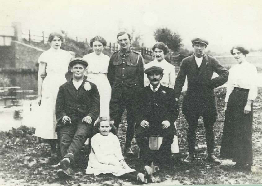 Charles Taylor, centre, and his family pose at West Row's Judes Ferry bridge. He died in France aged 27.